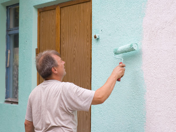 Painting a stucco house exterior