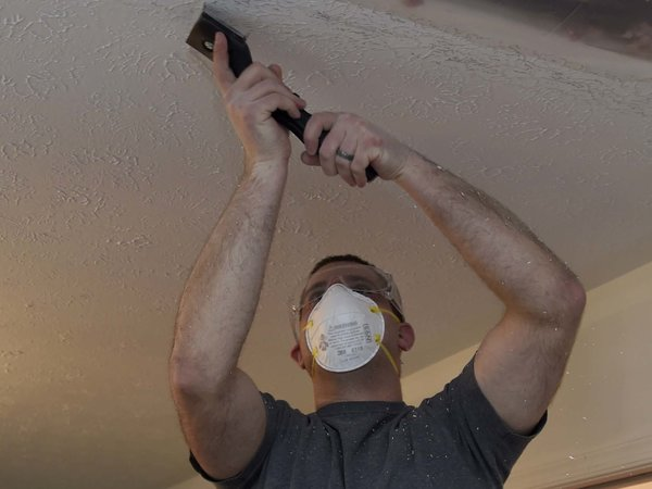 Man preparing a ceiling for painting