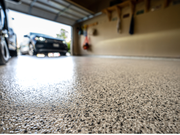 The cost to epoxy a garage floor like this changes based on epoxy type