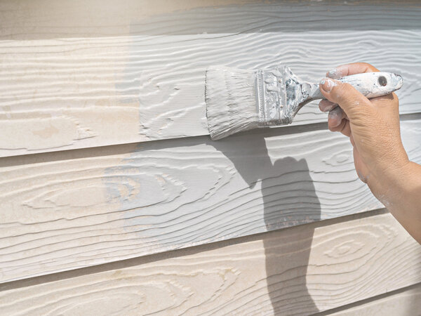 Painting a home exterior during the best temperatures to paint outside
